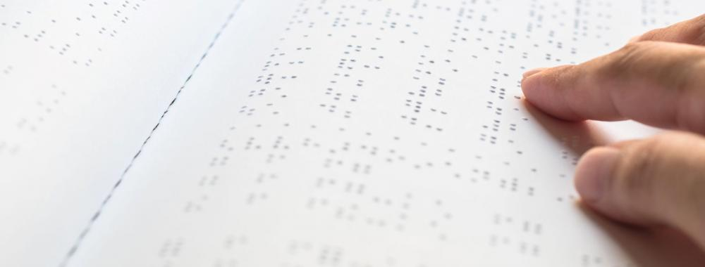 Hand reading Braille